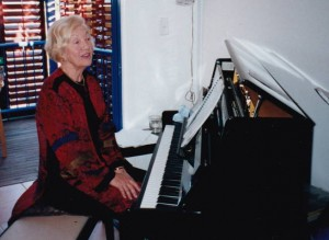 Margot red at piano